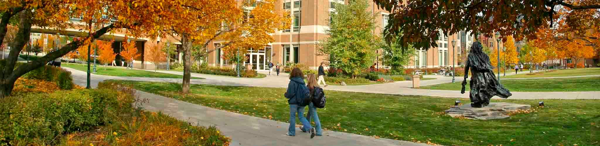 Two students walking toward Raynor Library