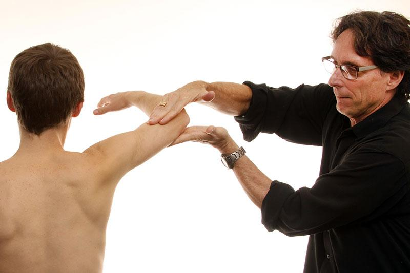 Dr. Donald Neumann, professor of Physical Therapy, gives a teaching demonstration.