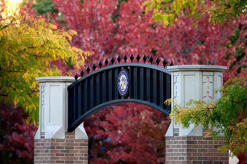Fall foliage surrounds the Marquette University archway on Wisconsin Avenue.