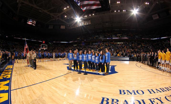Gold 'n Blues performing at basketball game