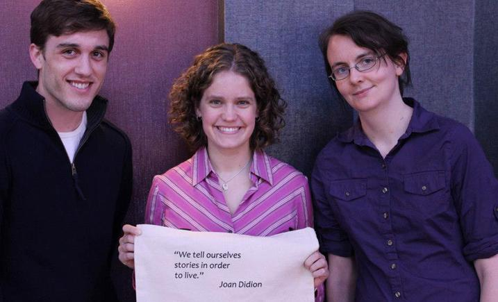 Students holding a banner with Joan Didion quotation