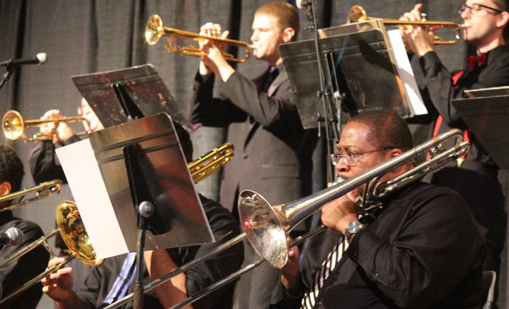 Trombone and trumpet players performing in band