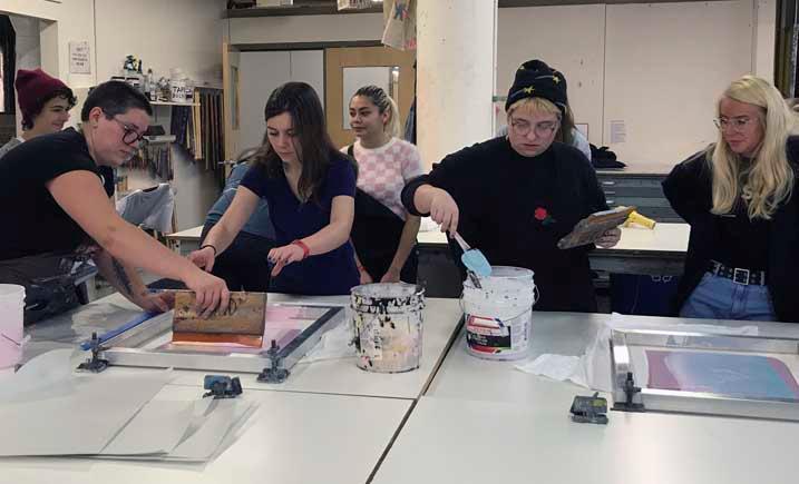 Marquette Art Club students working on silkscreening