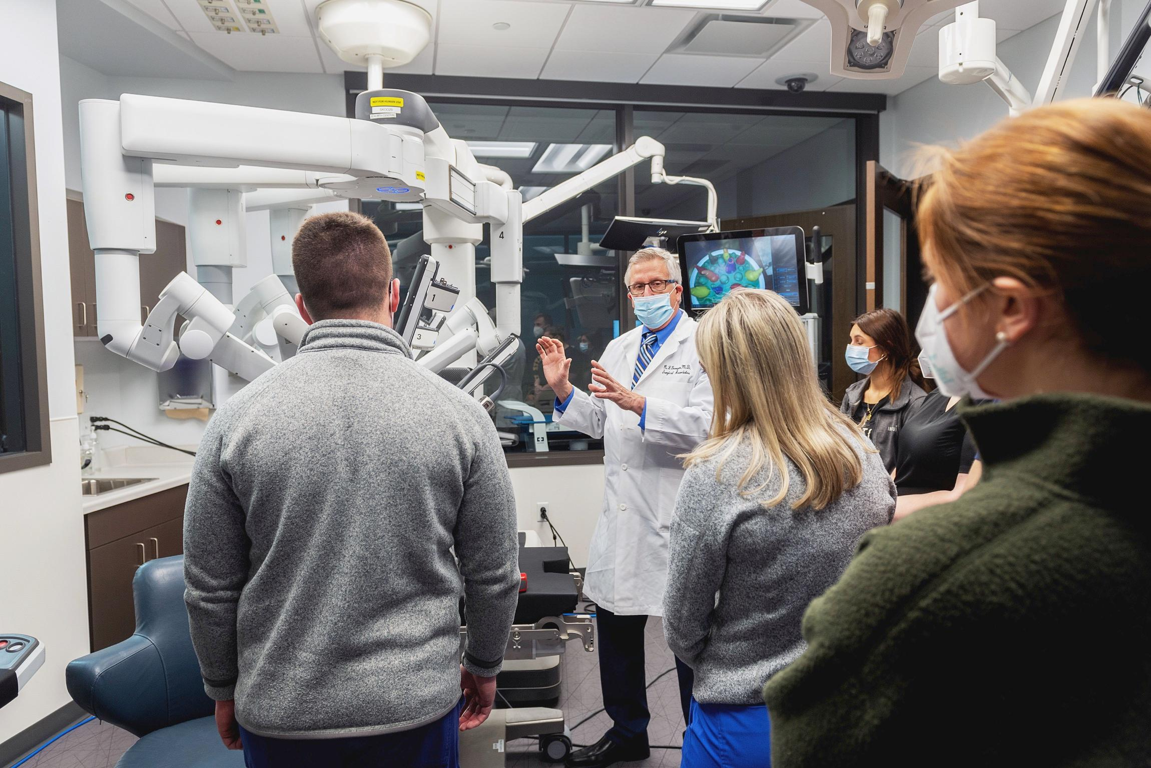 Dr. Georgen demonstrates the DaVinci Robot in the OR Sim