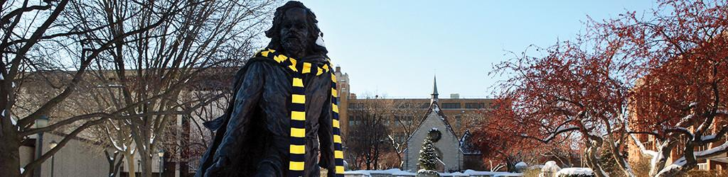 Marquette statue with scarf
