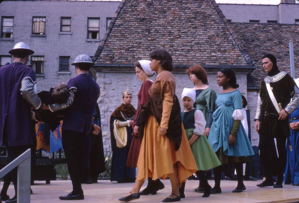 Soldiers carry Joan of Arc as King Charles VII looks on in this scene from the pageant produced by the Marquette Players for the dedication of the St. Joan of Arc Chapel in 1966.