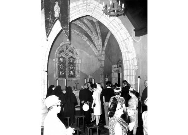A group gathers in the St. Joan of Arc Chapel, 1966