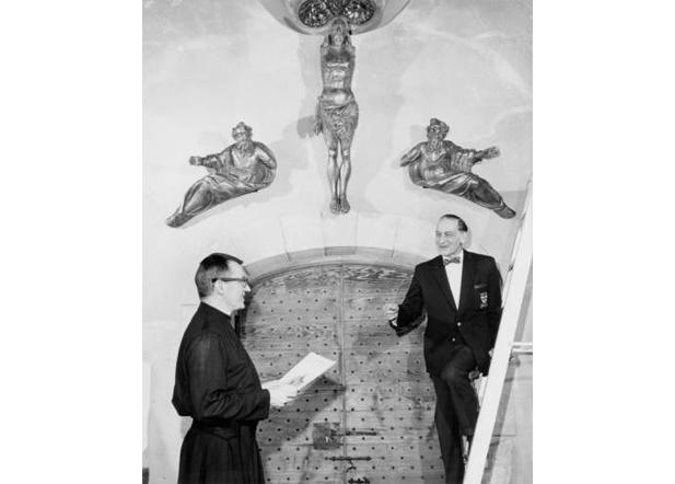 Wooden statues surrounding the main entry to St. Joan of Arc Chapel, 1966