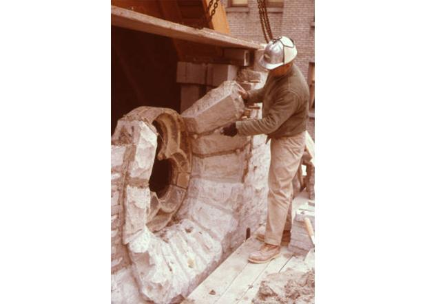 Workman setting stones as a part of the St. Joan of Arc Chapel's reconstruction on the Marquette University campus, circa 1966