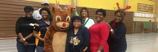 Ethnic Alumni Association volunteers at breakfast with Santa