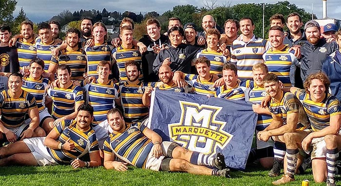 Rugby Team with MU Flag