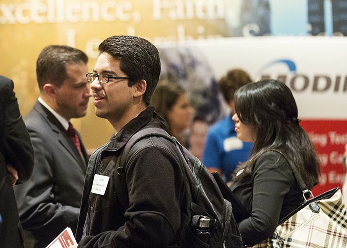Student interacting with an employer at a career fair