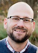 Dr. Adam  Fiedler