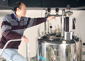 Chemist using NMR instrument