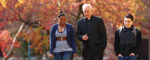 Students walking with Jesuit