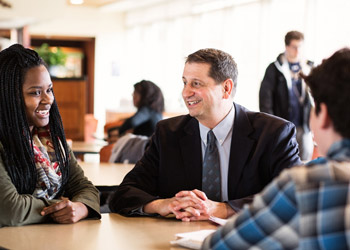 Dean William Henk with Marquette Students