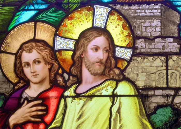 Jesus and St. John depicted in a stained glass window