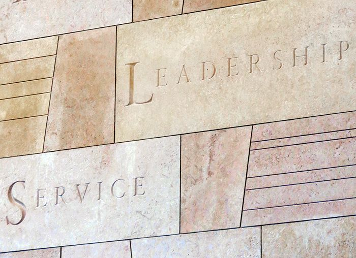 Leadership and Service engraved in stone