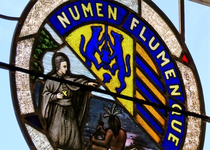 Stained glass window with the Marquette University seal