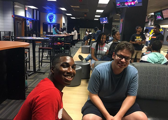 Student bowling at the Annex