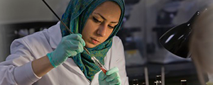 Biological Sciences female student working in a lab