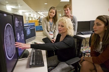nursing students looking at scans on a screen