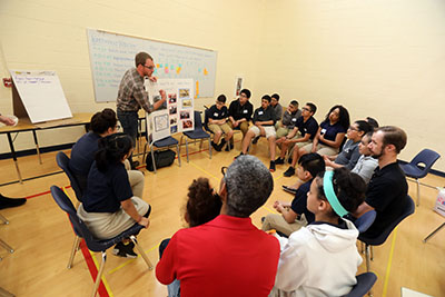 "Three teams of students served as ""captains,"" sharing their new knowledge with peers in a poster-board session and were accompanied by the walk facilitators."