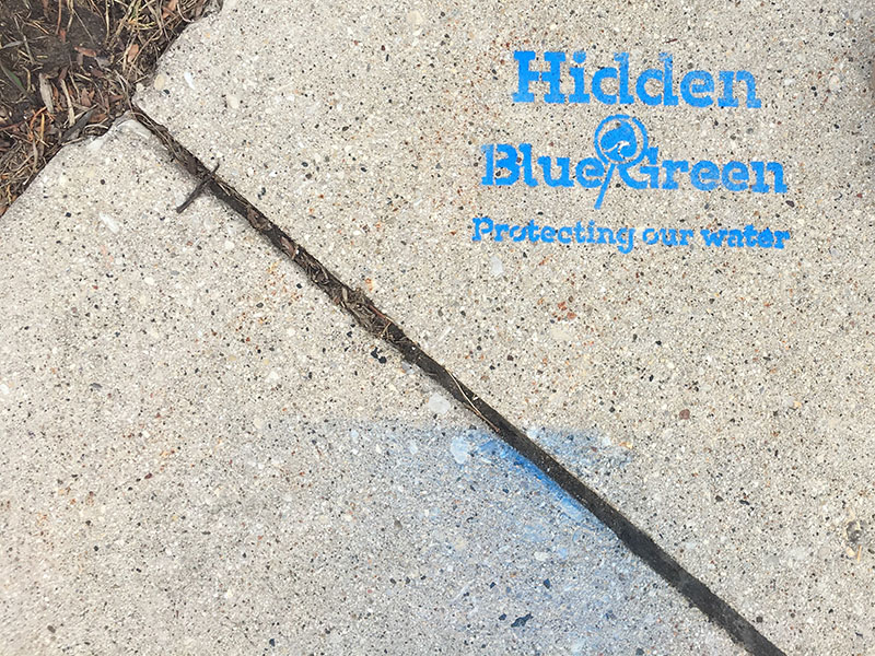 Exploring the Hidden Blue/Green text on the sidewalk