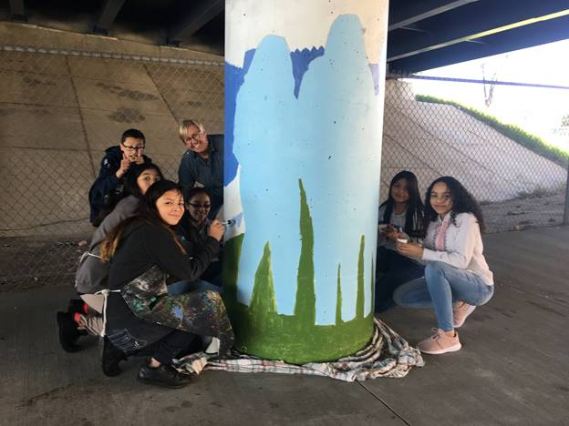 AMS students woking on the mural
