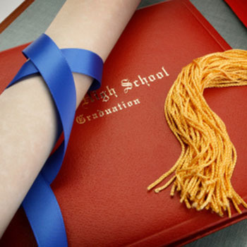 Diploma, tassel and scroll