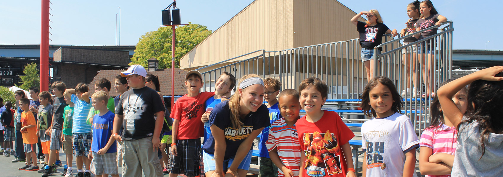Marquette student working with youth on Summerfest fair grounds