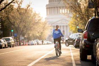 Marquette student on bike in Washington, D.C.