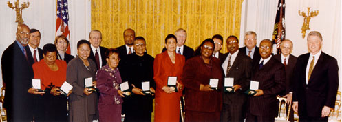 Little Rock Nine with President Bill Clinton after receiving their awards