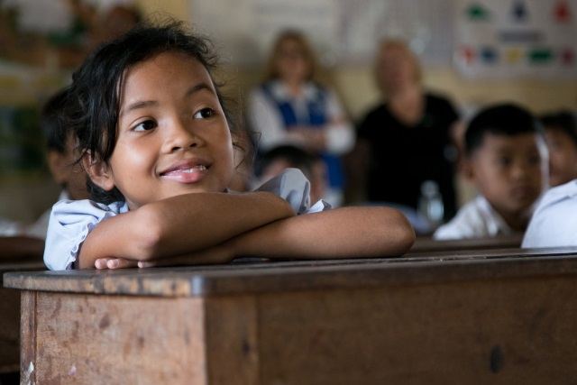 Catholic Relief Services in action - photo of a young girl in a classroom