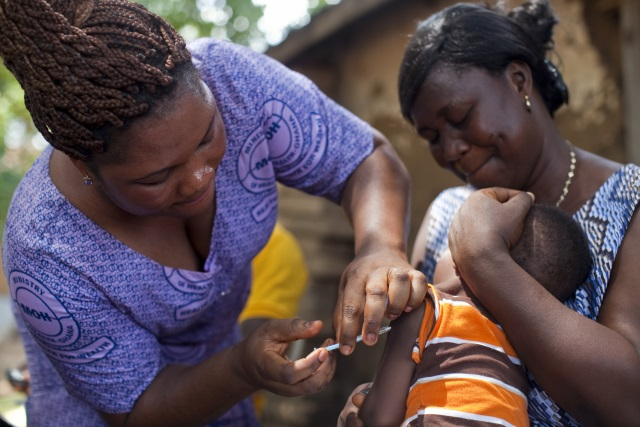 Catholic Relief Services in Action - photo of an infant being vaccinated