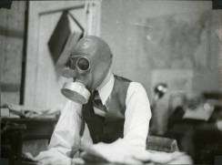 Shanke at his desk in a gas mask