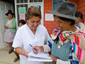 Image of a nurse working with a patient in Bolivia