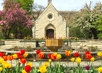 St. Joan of Arc Chapel behind tulips