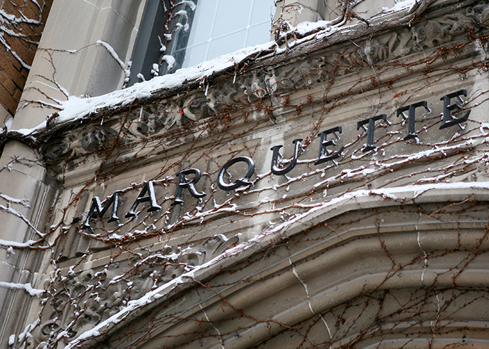 A snow covered building on the Marquette University campus