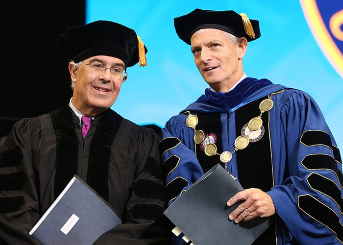 David Brooks and Marquette University President Michael R. Lovell at 2019 Commencement