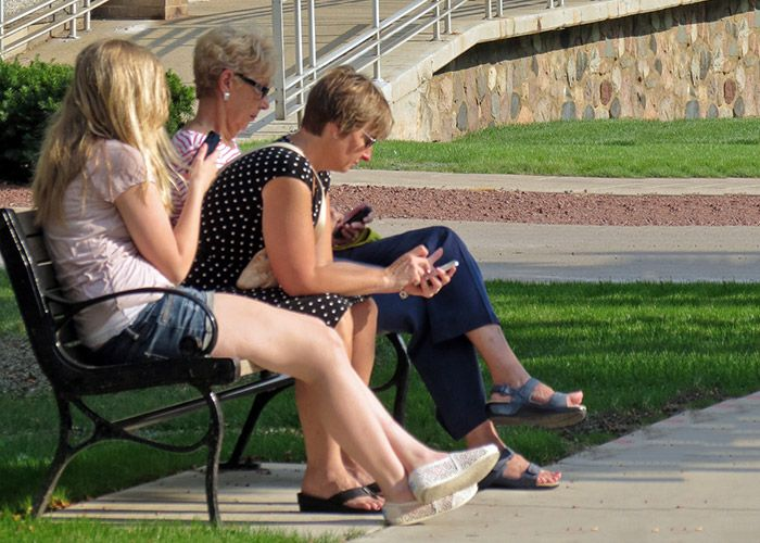 Campus visitors on a bench near Wehr Life Sciences building
