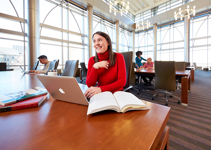 Student using laptop in Eckstein Hall reading room
